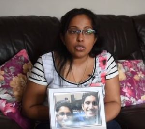Mother Suby Varghese holding a picture of her dead son and his cousin